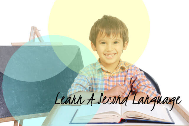 school boy with a book smiling
